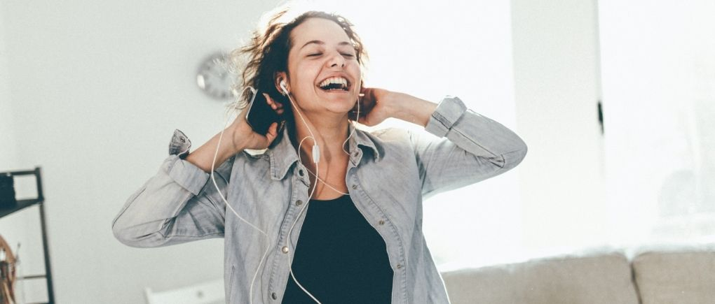 How to get your life back on track, woman dancing to be in a good mood