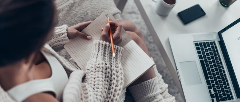 How to get your life back on track, woman writing down her goals