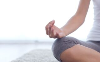 Woman meditating sitting on the floor